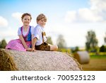two kids in traditional... | Shutterstock . vector #700525123