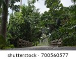 road through concrete bridges... | Shutterstock . vector #700560577