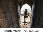 woman with the camera explores... | Shutterstock . vector #700561363