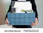 business woman packing personal ... | Shutterstock . vector #700562023