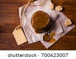 homemade caramel sauce in the...   Shutterstock . vector #700623007