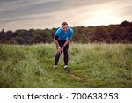 an exercising man in fit wear... | Shutterstock . vector #700638253