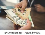client receiving money  south... | Shutterstock . vector #700659403