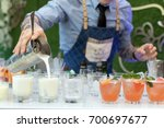 bartender pouring drinks at... | Shutterstock . vector #700697677