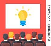 sitting people in auditorium... | Shutterstock .eps vector #700713673