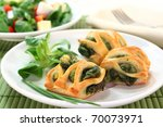 Puff pastry with a spinach-cheese filling and corn salad - stock photo
