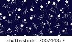 seamless little flowers. floral ... | Shutterstock .eps vector #700744357