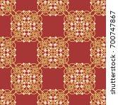 elegant golden knot sign. red... | Shutterstock .eps vector #700747867