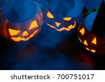 three halloween pumpkins with... | Shutterstock . vector #700751017
