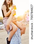 young couple drinking beer and... | Shutterstock . vector #700784827