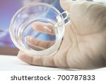 handle the glass of drinking... | Shutterstock . vector #700787833