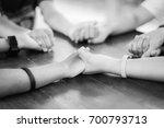 hand hold praying family.... | Shutterstock . vector #700793713