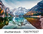 first snow on braies lake.... | Shutterstock . vector #700797037