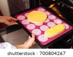 the confectioner puts the... | Shutterstock . vector #700804267