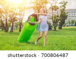 a woman tries to inflate an air ... | Shutterstock . vector #700806487