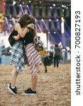 friends at festival hugging | Shutterstock . vector #700827193
