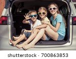 happy brother and his two... | Shutterstock . vector #700863853