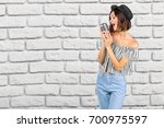 young woman singer | Shutterstock . vector #700975597