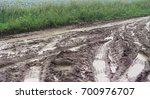 wet mud tracks from a tractor... | Shutterstock . vector #700976707