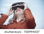 woman at office wearing virtual ...   Shutterstock . vector #700994437