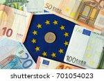 euro money on the euro flag | Shutterstock . vector #701054023