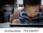 child addicted phone. asian boy ... | Shutterstock . vector #701136907