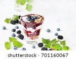 berry smoothies with yoghurt ... | Shutterstock . vector #701160067
