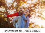 happy family on autumn walk ... | Shutterstock . vector #701165023