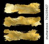 collection of golden paint... | Shutterstock .eps vector #701235427