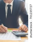 business man using calculator... | Shutterstock . vector #701235727