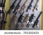 pneumatic gun hangs on the wall ... | Shutterstock . vector #701302423