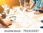 brainstorming team of asian... | Shutterstock . vector #701313337