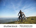 cyclist couple with mountain... | Shutterstock . vector #701332123