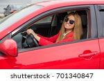 girl in a red car in glasses | Shutterstock . vector #701340847