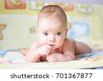 the baby is lying on a yellow...   Shutterstock . vector #701367877