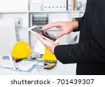 young man working and touching... | Shutterstock . vector #701439307