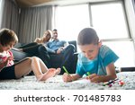 happy young family playing... | Shutterstock . vector #701485783