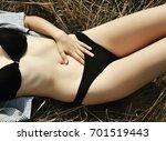 girl lying on the grass... | Shutterstock . vector #701519443