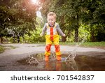 child in rainy day. cute happy... | Shutterstock . vector #701542837