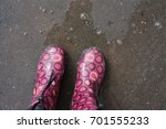 pink rubber boots in shallow... | Shutterstock . vector #701555233