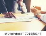 business team discusses... | Shutterstock . vector #701650147