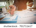 a businessman analyzing... | Shutterstock . vector #701711617