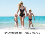 beautiful mother and two lovely ... | Shutterstock . vector #701770717
