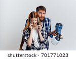 man with a woman holding... | Shutterstock . vector #701771023