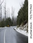 snow on trees and road in... | Shutterstock . vector #701791963