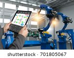engineer hand using tablet ... | Shutterstock . vector #701805067
