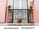 lisbon pink house and balcony | Shutterstock . vector #701843977