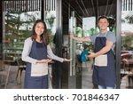 waiter welcoming customer to... | Shutterstock . vector #701846347