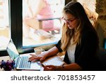 the girl buys via the internet... | Shutterstock . vector #701853457