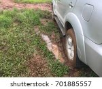 Small photo of Car mired mud after rain